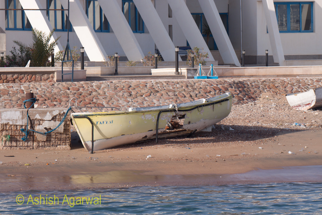 A broken boat taken out of the water for repair in Sharm el Sheikh in Egypt