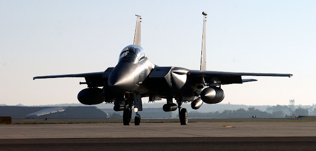 An F-15E Strike Eagle waits at the end of the runway.
