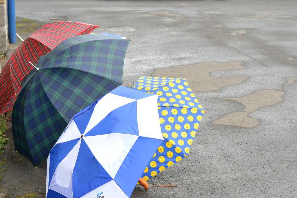 umbrellas street rain