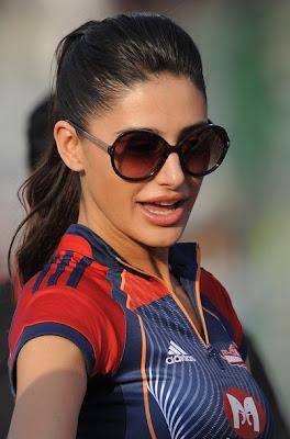 Nargis Fakhri Spotted at IPL Match to support Delhi Daredevils team in Delhi Team dress