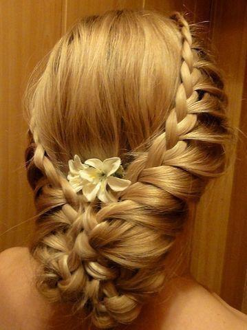 Birds nest style hair design for ladies