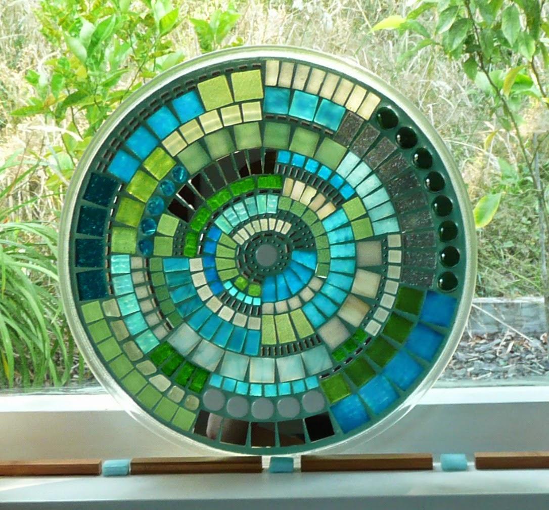 http://felt.co.nz/listing/192318/Aqua-Sea-Green-Blue-Glass-MOSAIC-Vortex-Heatproof-Trivet--Candle-base--Fruit-Plater-