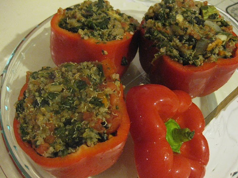 these beautiful red peppers are stuffed with quinoa black beans and ...