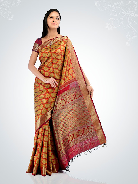 wedding sarees, kanchipuram silk sarees,Kanch Pattu Saree,New Indian Designer Collection of Bridal Sarees ,Cotton Sarees, Cotton Designer Saris,Cotton Sarees,bridal saree, wedding sari, party wear sarees, traditional indian sarees like zari, silk, printed,I can see most of the visitors who visits my blog are interested in kanchipuram saris. This made me write another post about kanchipuram saris. No wonder women are attracted by kanchipuram saris as it adds grace and elegance to the woman who wears kanchipuram saris. I make it a point to buy at least 4 saris every year, one for dipawali, one for pongal a festival for Tamils, one for varalakshmi vridham a fasting usually made by all the married women for the long life of their husbands. The fourth one just like that say for our wedding anniversary or my birth day I used to buy. I live in Noida a place in the northern part of India where one can hardly find any shop for kancipuram saris. Delhi is only 2-3 kms far from Noida here I am saying the border of Delhi from Noida and in Delhi there is Nalli silks a popular shop for kanchipuram saris. Nalli has 3 branches I guess in Delhi. The main one is in the south extension market, the second one in cannaught place and I am not that sure where the third one is. But I used to make all my purchases at Chennai or at Tirunelveli when I go there for summer vacations. Rmkv and Pothys are very popular in Tirunelveli, in fact they opened their first showrooms at Tirunelveli only. Rmkv is like our family shop because for generations we purchase kanchipuram saris from this shop for all the special occasions in our family. My grand mother and all my aunts are very superstitious and they believe that everything will be perfect and nothing wrong will happen if they make their purchases from Rmkv. But I am not that superstitious all though I like Rmkv when I visit Chennai I go to other shops also. If you ask me all the shops are good to buy kanchipuram saris. Some of my favourite shops among them are sundari silks, palam silks, tulsi silks. In sundari silks one can get plain kanchipuram saris without any zari or designs in very attractive colour combinations. One can buy these saris and customize them according to their taste. One can customize it with zardoshi work, kundan work, sequins work and also with some simple yet elegant embroidery work. I heard lot of ladies in Chennai are doing these work from the home itself as a part time job and some of them have taken it seriously and doing it very professionally also. My sister in law who stays in chennai said that in Sundari silks itself they are doing these works on our request but Iam not very sure of that. Today the latest trend in kanchipuram saris are with a broad border in both sides. It is called muppaham pattu in Tamil. Muppaham means three parts in equal size. These saris look very nice but I feel it suits only for women who are tall and slim. For healthy women like me :) I think it makes us look more healthy :)) and also short. It is not wrong in following the latest trend but I feel that it should also suit the personality of the individual. If you have a girl child then please do not miss the kanchipuram pattu paavadai (silk skirt) . In this skirt your child will definitely look like an angel that I can guarantee you. If you have teenage daughter then make them wear the kanchipuram silk skirt and half sari (Dhaavani) with their hair plaited or if they have very short hair one can try french plaits and with some simple accessories they will look gorgeous for sure. I don't have a girl child so no way I can try these things but whenever I see these silk skirts and outfits for girls I really feel very sad because I don't have a girl child. Above are some photos of kanchipuram saris which I like and for online shops to buy kanchipuram saris visit the online shops at the top of the blog