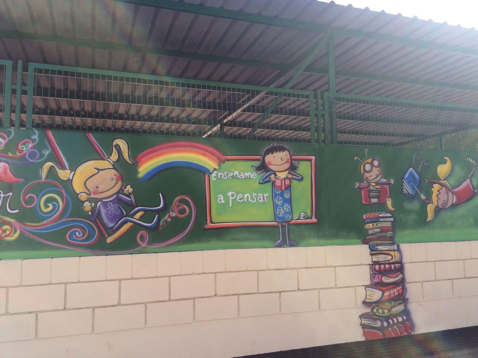 pintura de les tanques de l'escola realitzada per l'AMPA