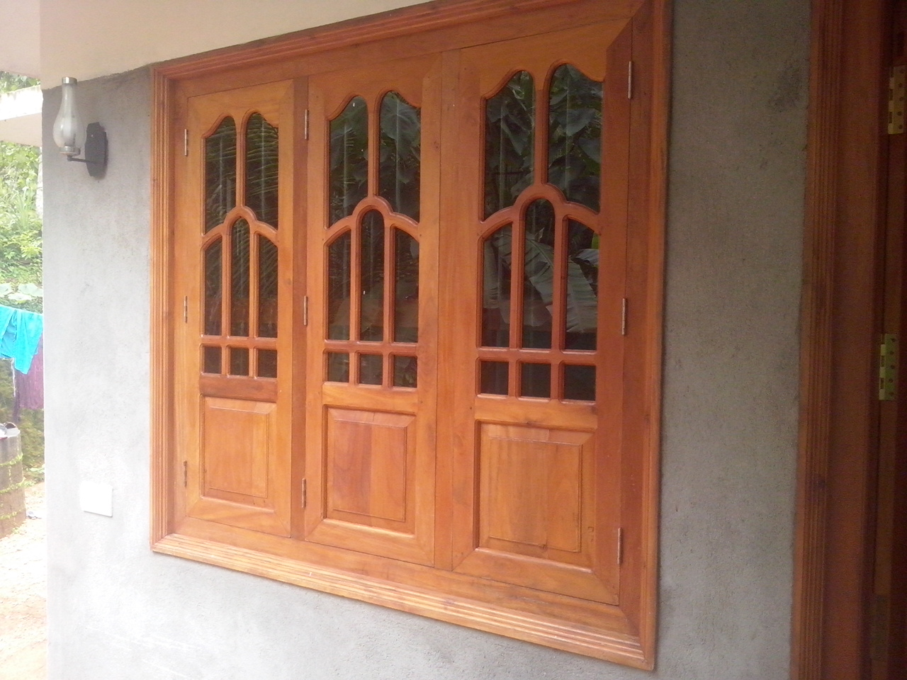 Bavas wood works kerala style wooden window door designs for Window glass design in kerala