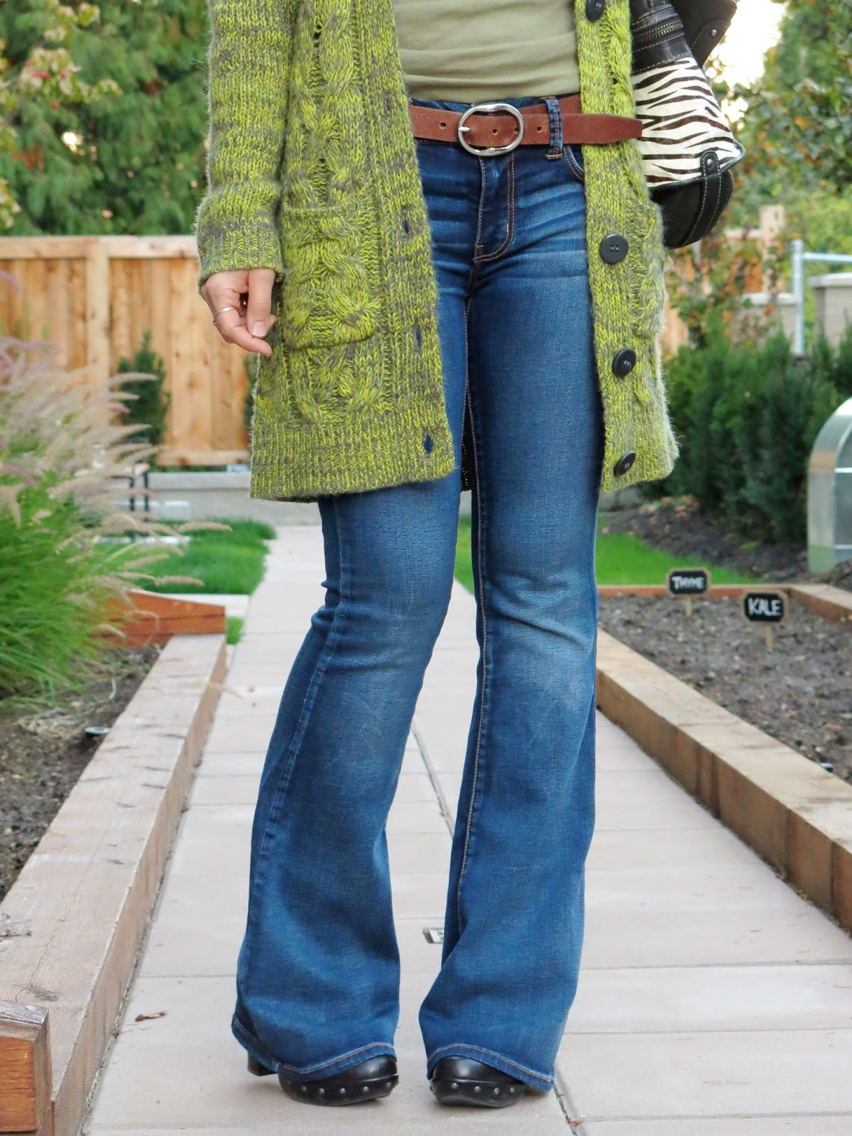 flare jeans and a chunky grandpa cardigan