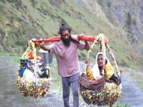 This `Sravan Kumar' of the 21 century is carrying his visually challenged mother on his shoulders on a `Char Dham' yatra by foot.