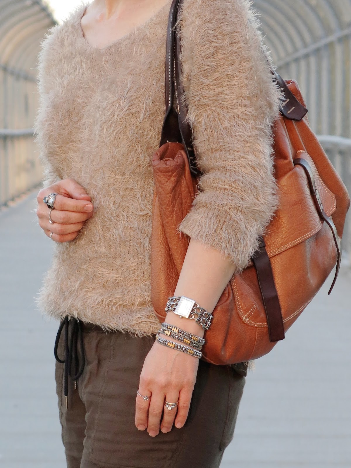 fuzzy sweater and cognac satchel