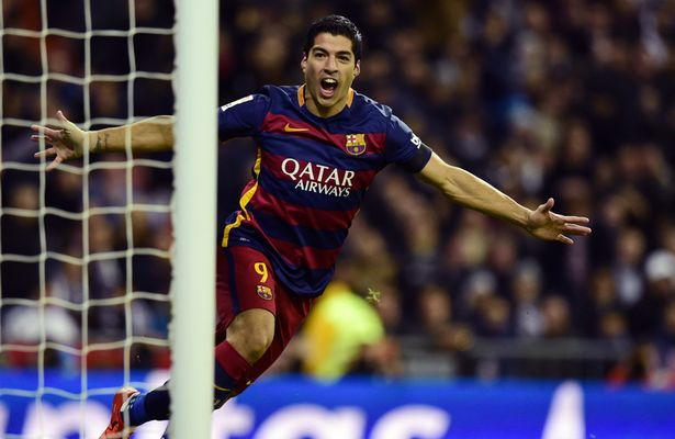 Breakthrough: Luis Suarez celebrates after scoring the first goal for Barcelona