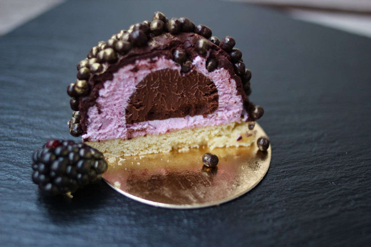 ... cremeux inside a tart blackberry mousse and covered the cake with
