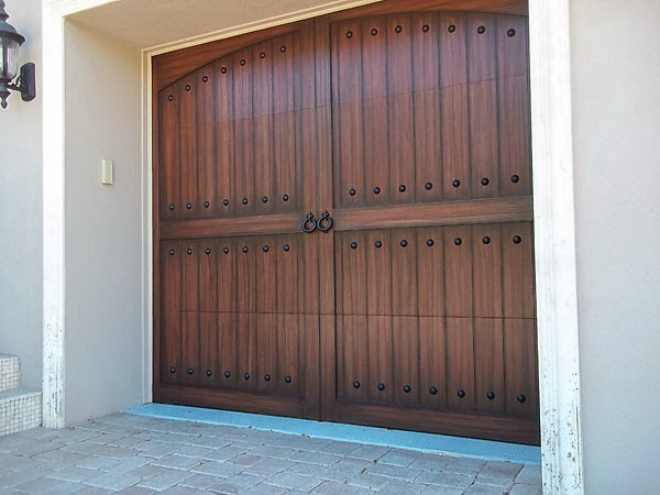 carriage style garage door painted to look like wood