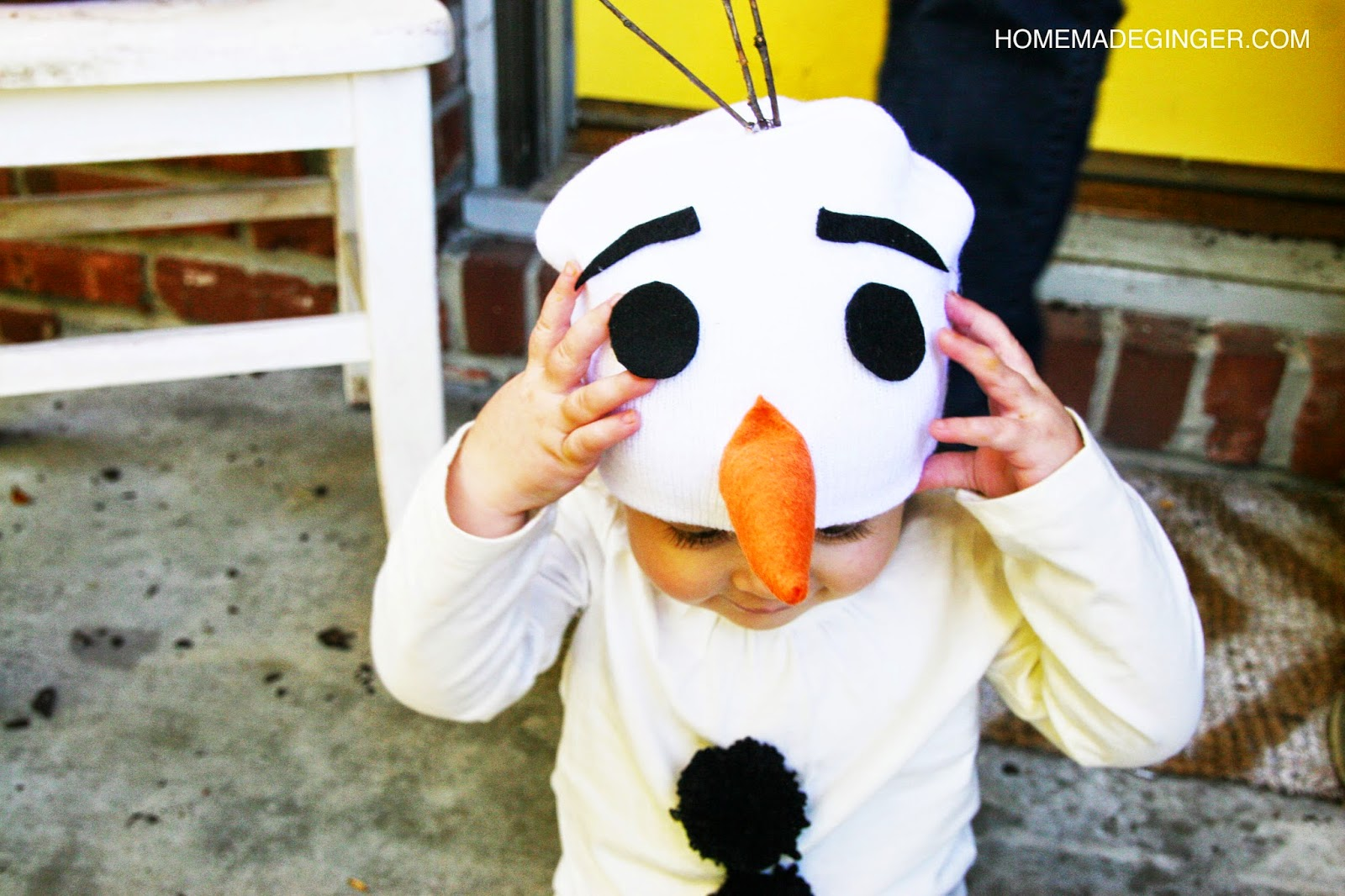DIY snowman costume using white onesie and beanie hat