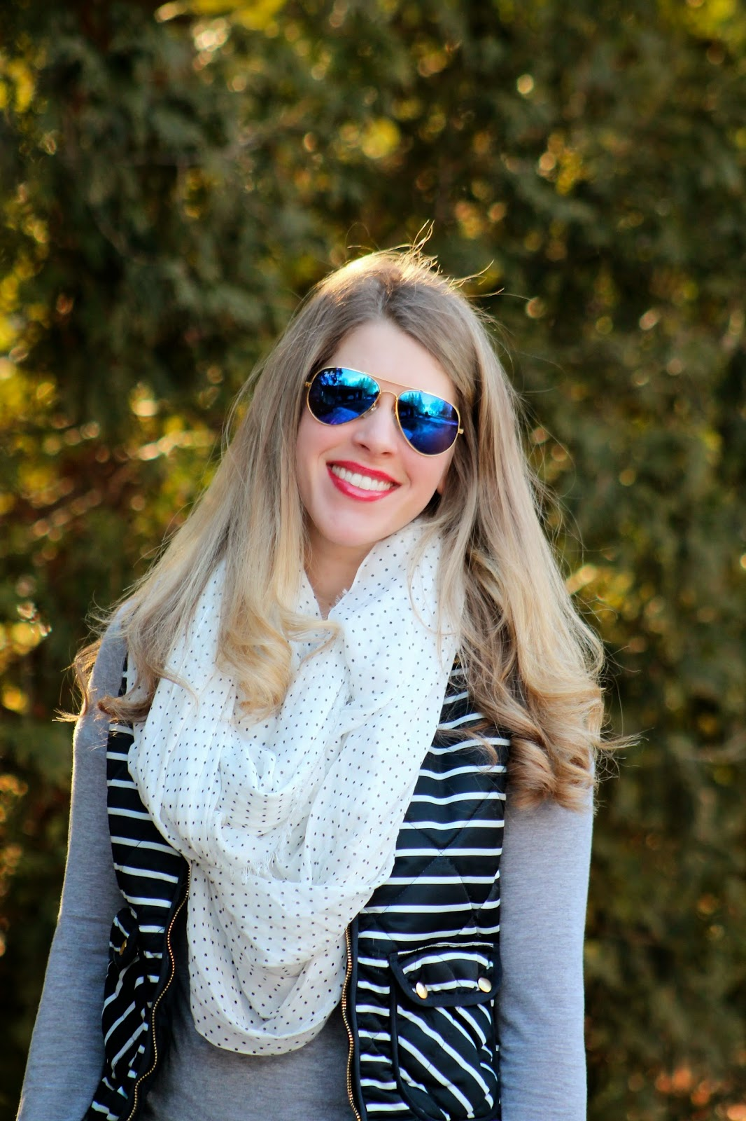 striped vest polka dot scarf and distressed jeans spring outfit