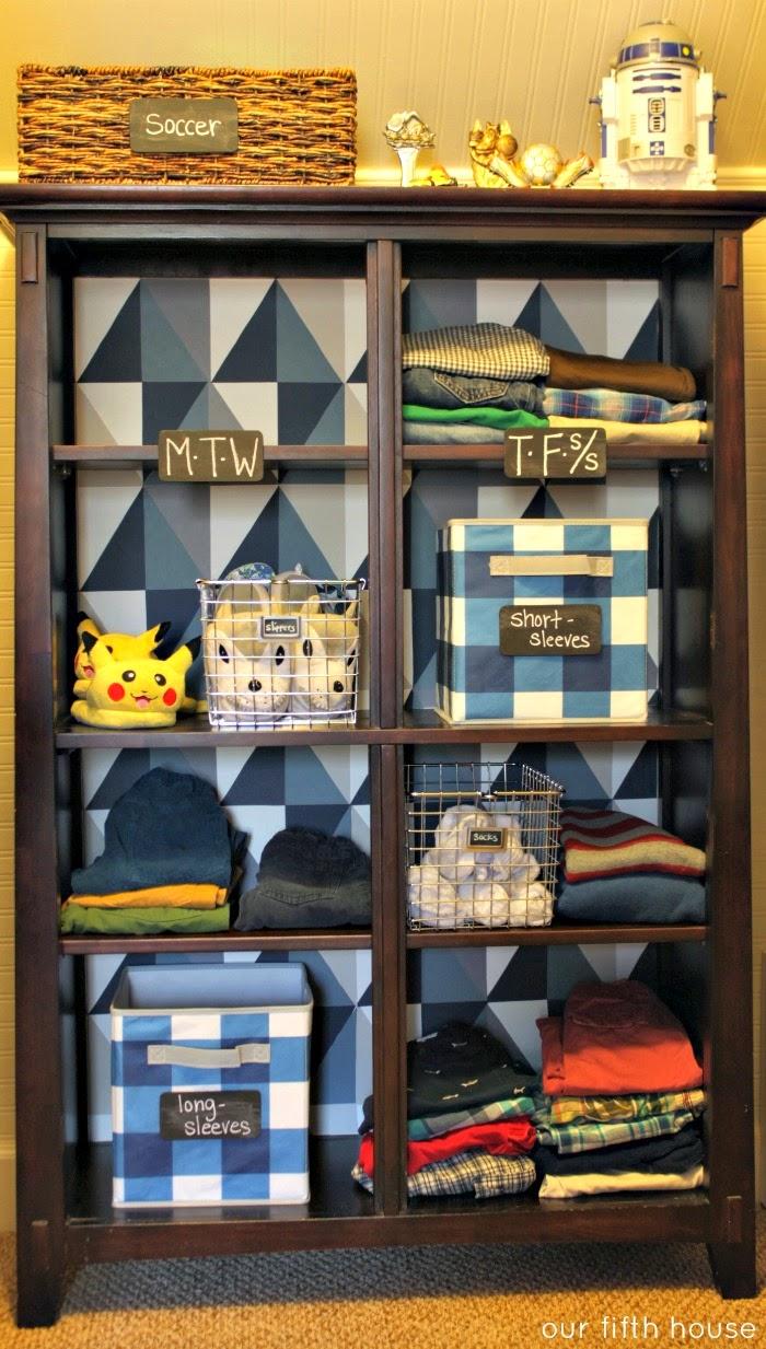 diy geometric wallpaper on back of bookcase