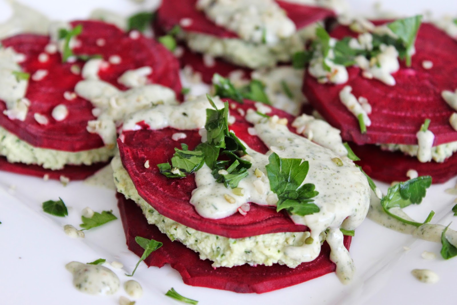 Raw Beet Ravioli with Macadamia nut cheese and hemp drizzle