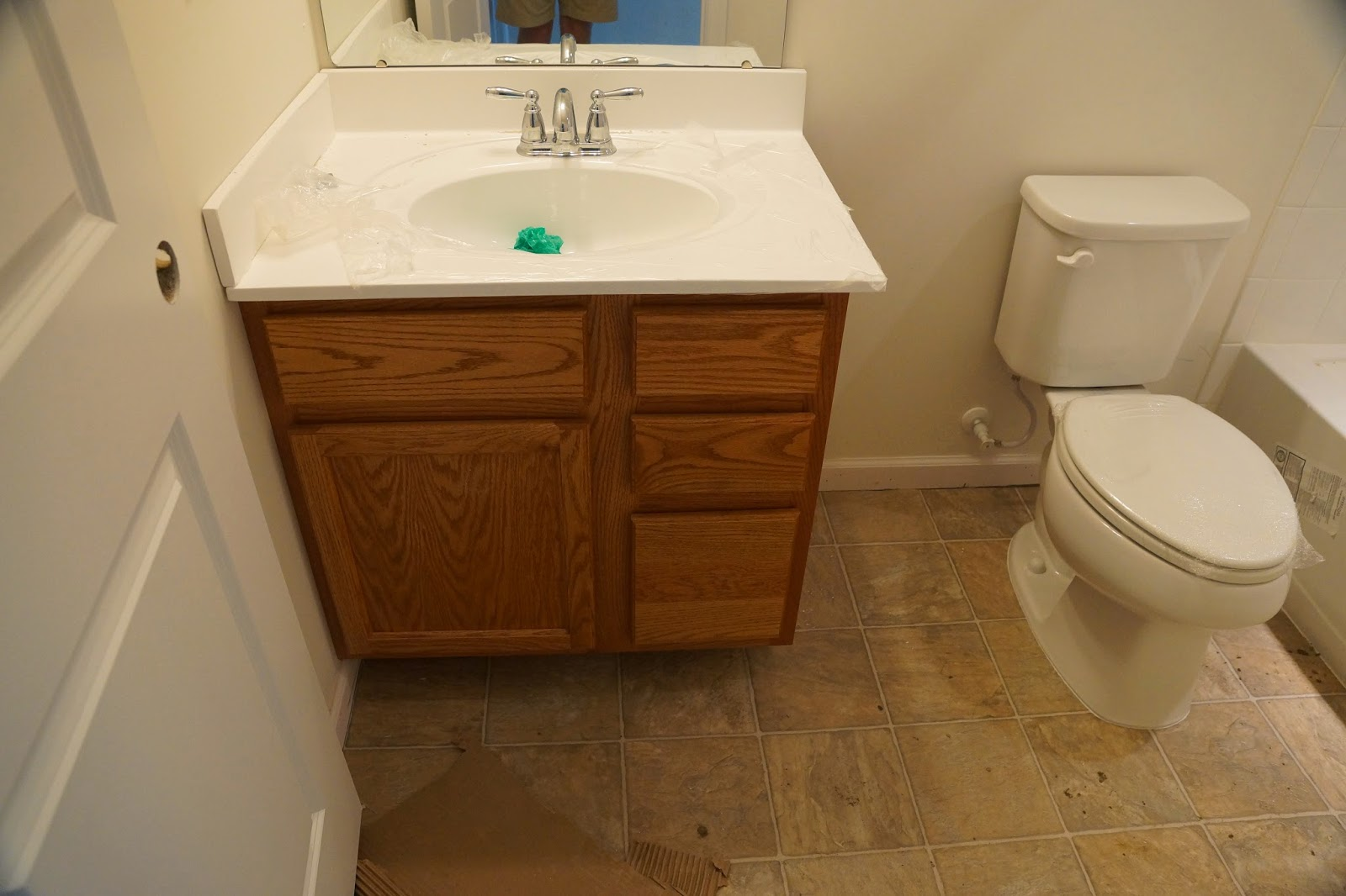 Picture of the hallway bathroom sink and toilet