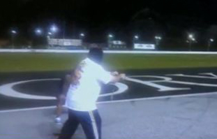 moodini magician is dragged behind a race car