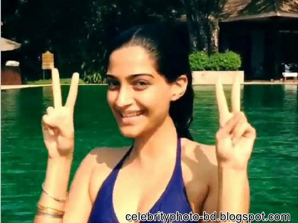 Sonam+Kapoor+welcomes+New+Year+2014+in+Hot+blue+Bikini003