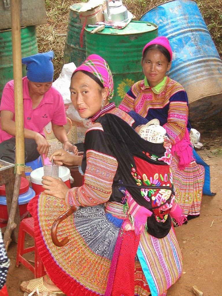 Flower Hmong woman wearing pleated skirt