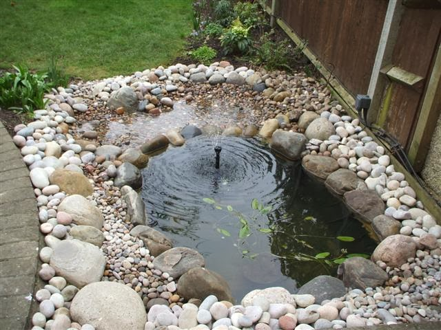 Beach pebbles and other landscape ideas for Ornamental fish pond construction