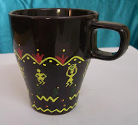 Creative Warli design on a coffee mug