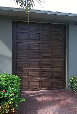 RV garage door painted like wood