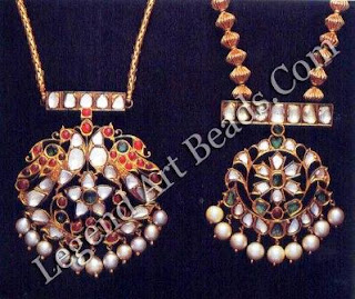 Closed set, but simulating kundala velai, with diamonds, rubies and emeralds, the gently curved form of the pendants adds a lifelike quality to the peacock and floral motifs.
