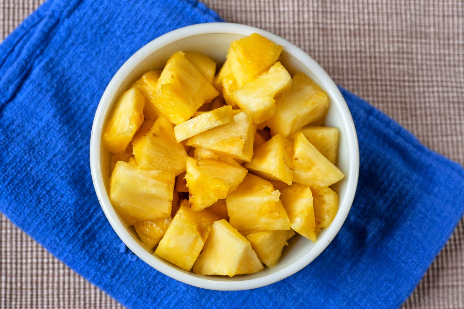A bowl of chopped pineapple