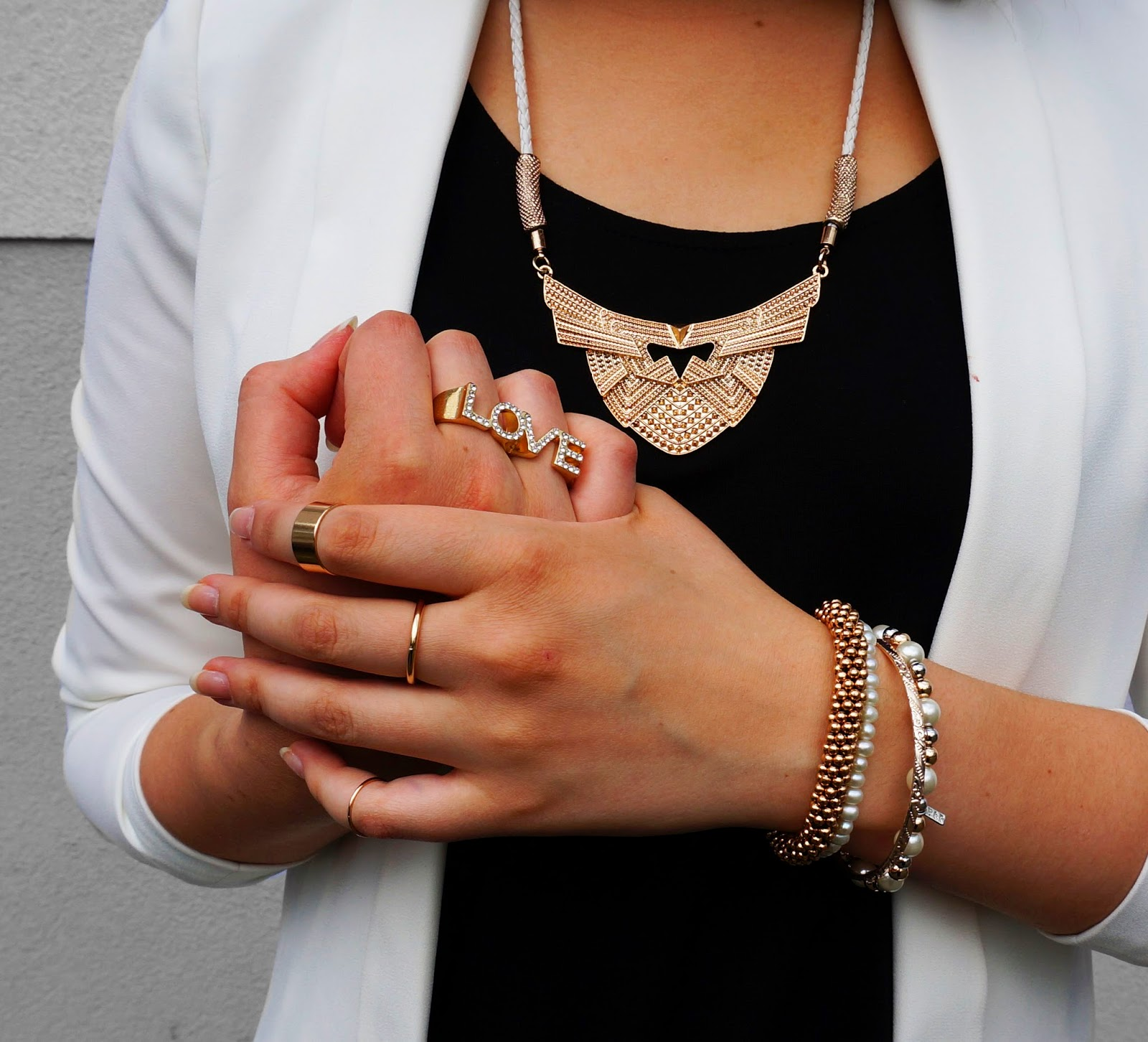 golden jewellery. statement necklace. statement ring. golden rings
