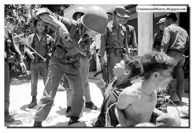 South Vietnam soldiers interrogates Vietcong prisoner