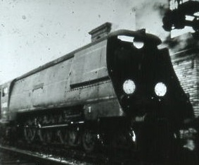 34033 'Chard' on down passenger train at Fareham 1955