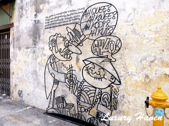 penang street art iron wall caricatures