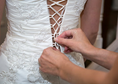 Lacing up brides dress