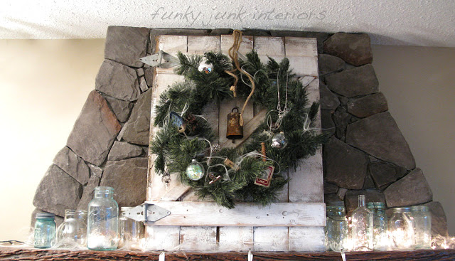 Illuminated mason jars on Christmas mantel via Funky Junk Interiors