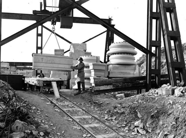 Easton, Bath and Portland Stone Firms, Ltd., Portland. Travelling crane lifting block of masonry in Portland Stone. Works of Bath and Portland Stone Firms, Ltd.