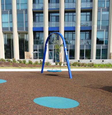 A Modern Day Playground swing