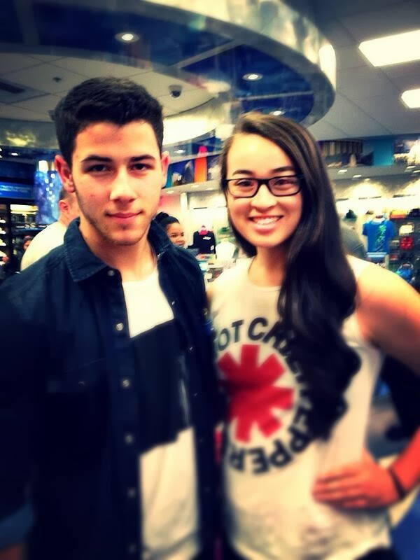 Nick Jonas With a Fan at LAX