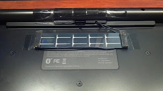 solar panel attached to back of a keyboard