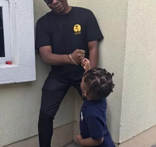 Olamide Baddo and son