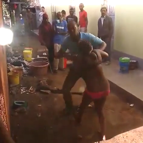 staying flocus neighbours stand and watch as man beats his wife