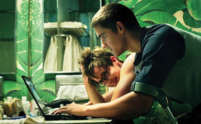 Nic (Thwaites) and Jonah (Knapp) track Nomad online in THE SIGNAL (2014)