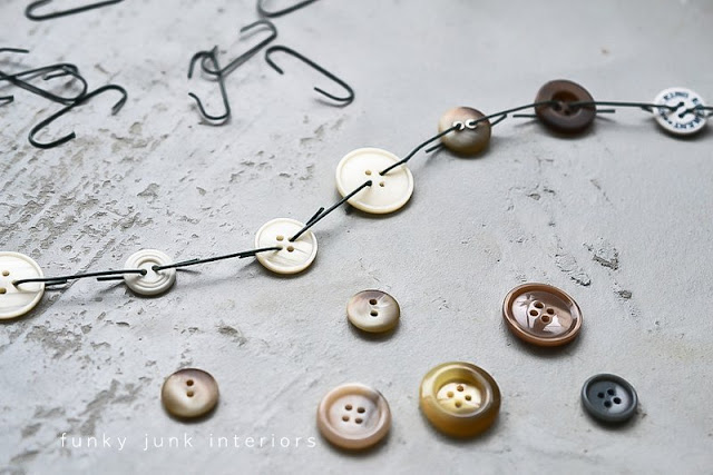 Make a button garland with ornament hooks - via Funky Junk Interiors