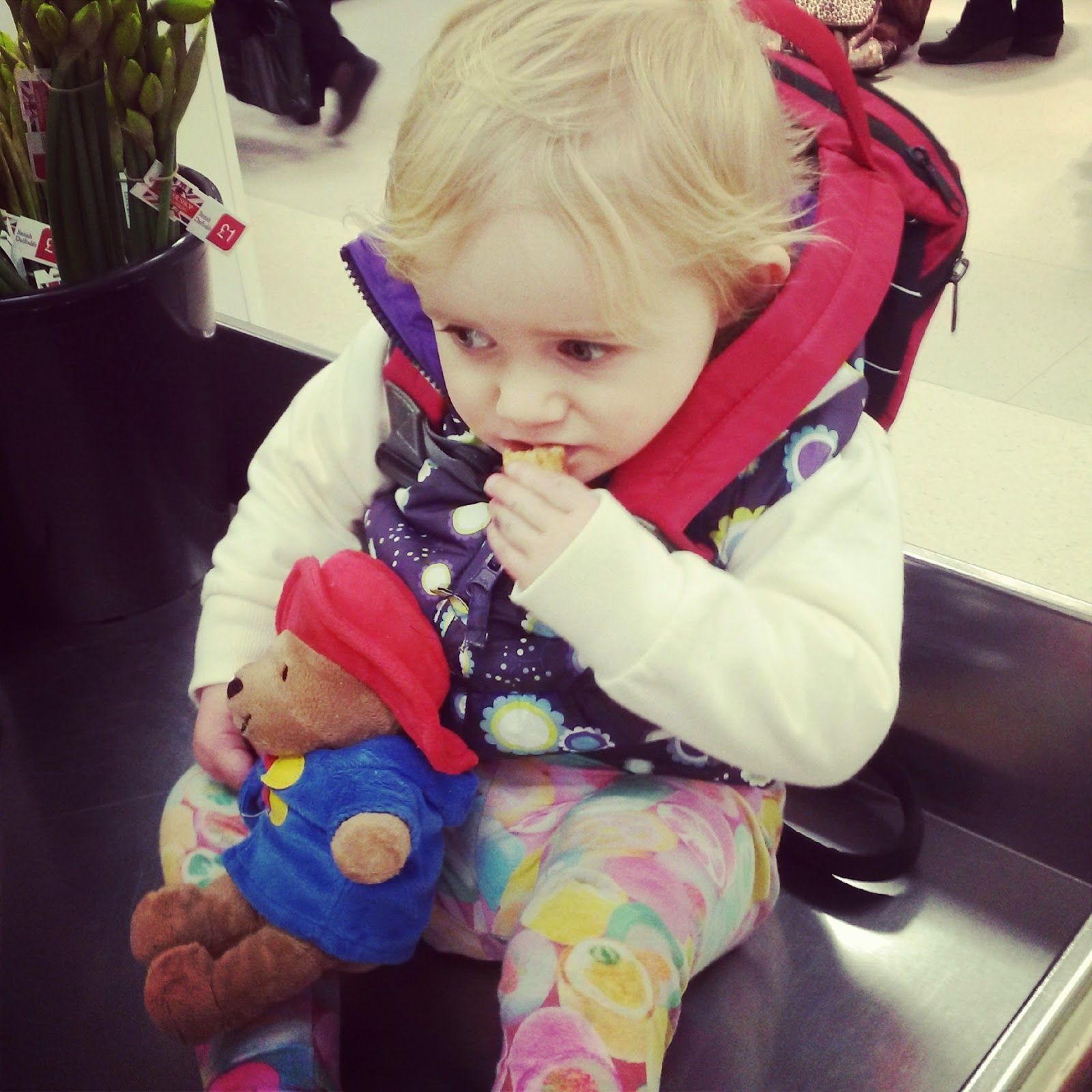 Paddington & toddler on M&S checkout