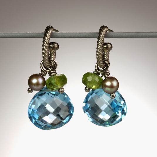 http://quadrumgallery.com/jewelry/product/twisted-hoops-with-pearl-peridot-and-topaz-drops