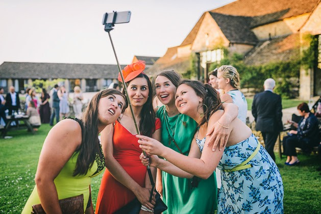 Selfie Stick: New Trend Not to Be Missed | Guests using a selfie stick in a wedding