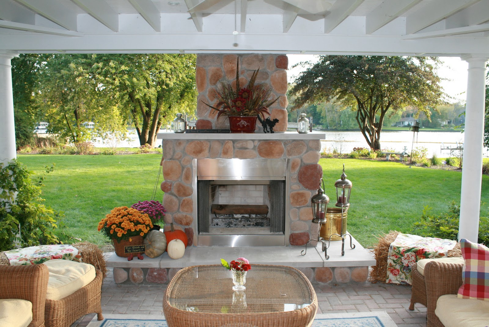 outdoor living room living large in a small house because our home is so small we put a roof on our open outdoor pergola we added a pre fab wood burning fireplace some outdoor furniture from home depot