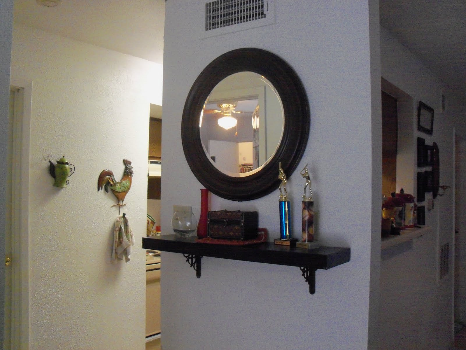 Mirrored floating wall shelves 15 image wall shelves for Hallway mirror and shelf