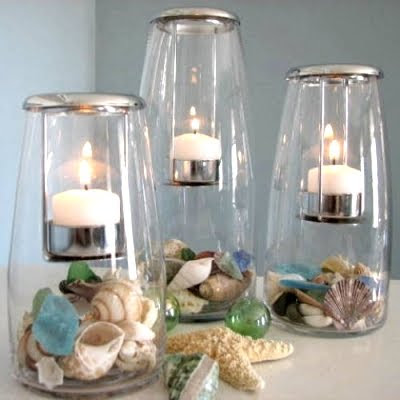 votive candle holders filled with shells