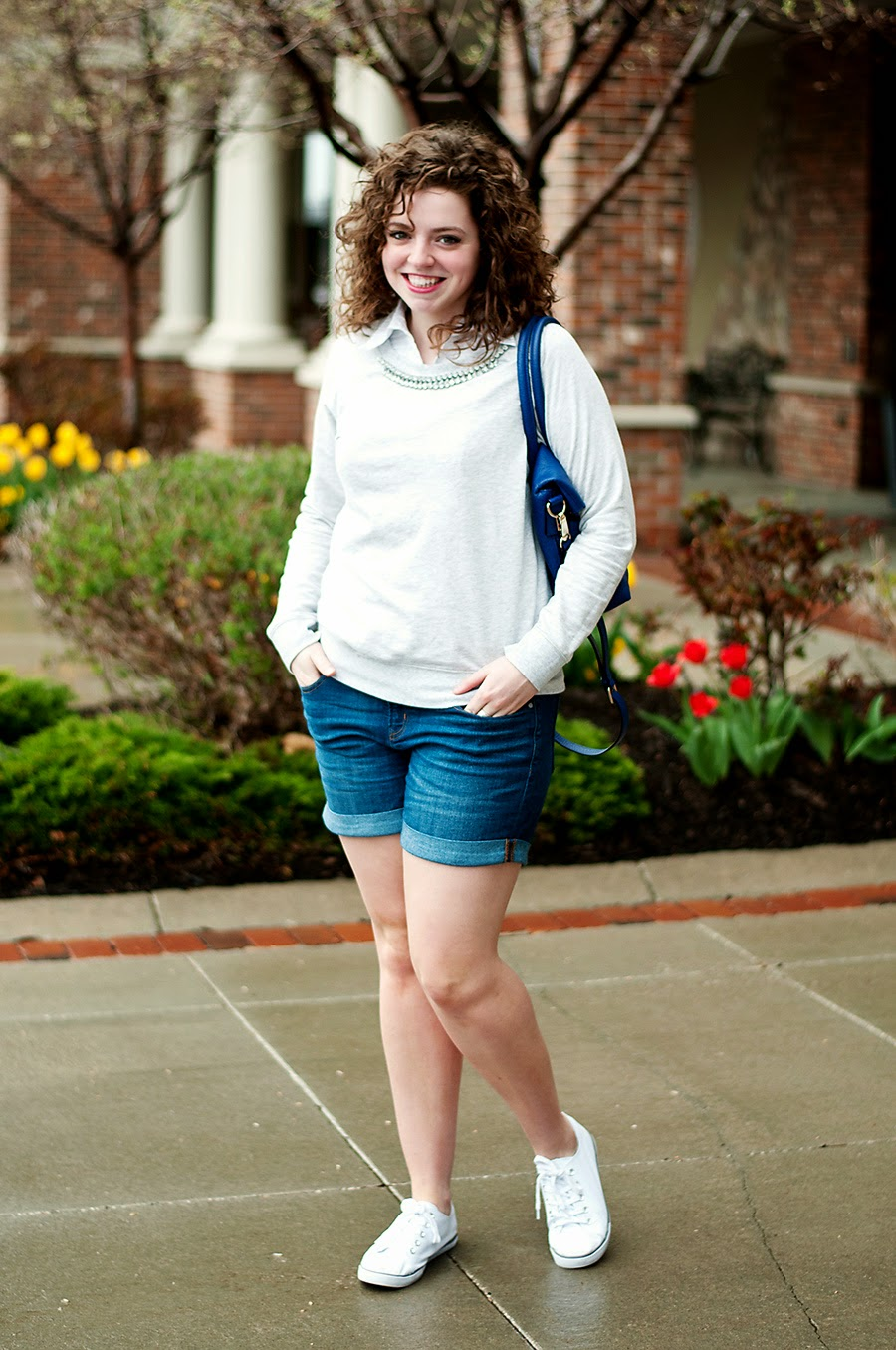 Spring outfit with jeweled sweater and canvas sneakers
